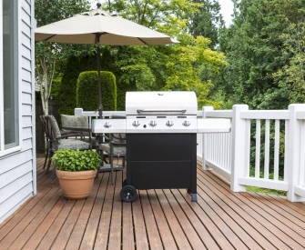 White barbecue on a wooden deck